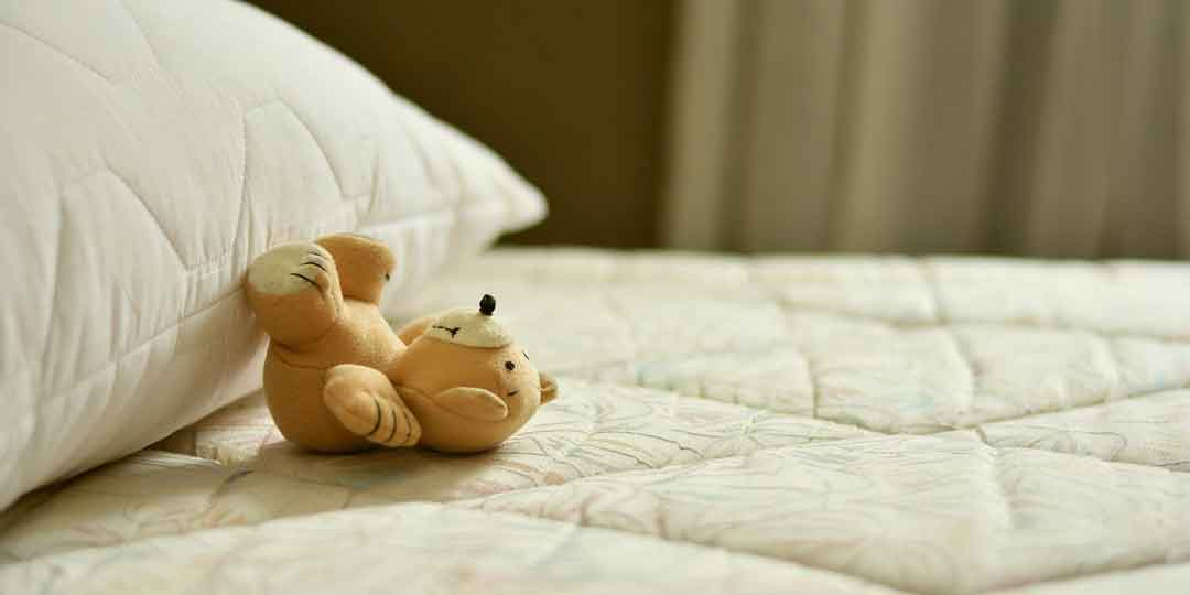 Teddy Bear on a Mattress