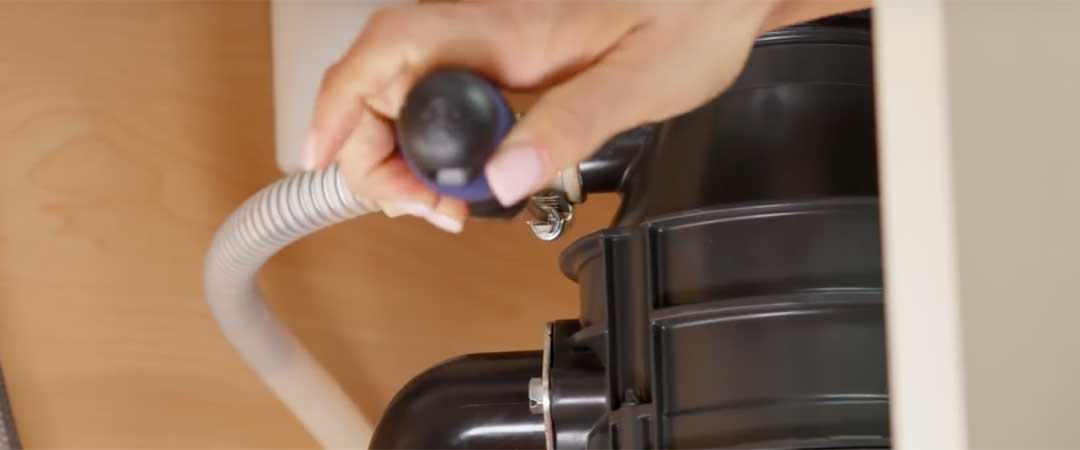 Attach the dishwasher drain to the garbage disposal